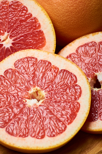 Sliced Juicy Red Grapefruit Close Up Stock Photo - Download Image Now