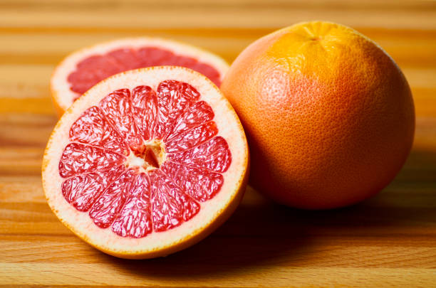 sliced juicy red grapefruit on a board
