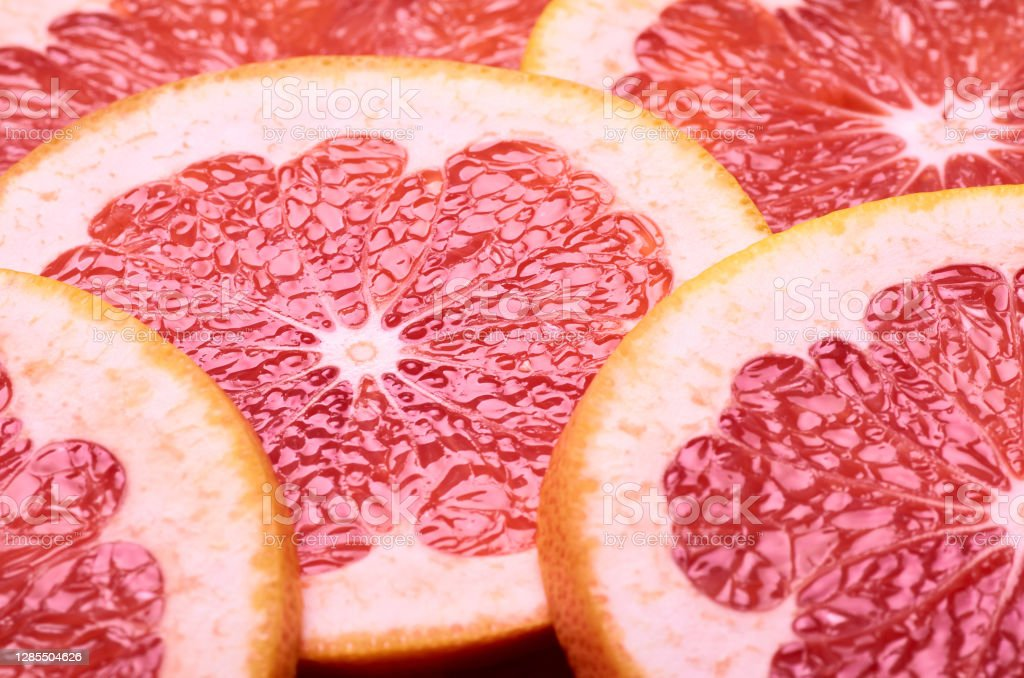 sliced juicy red grapefruit sliced juicy red grapefruit close-up Bright Stock Photo