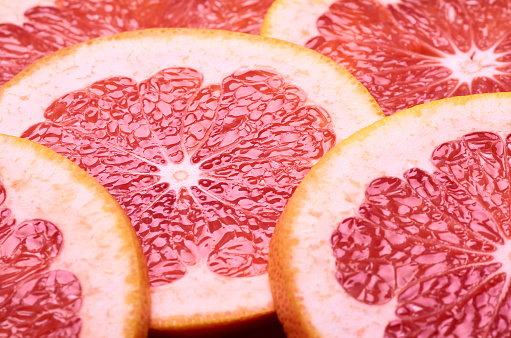Sliced Juicy Red Grapefruit Stock Photo - Download Image Now