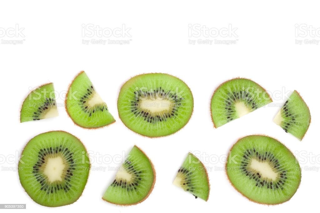 sliced kiwi fruit isolated on white background with copy space for your text. Flat lay pattern. Top view stock photo