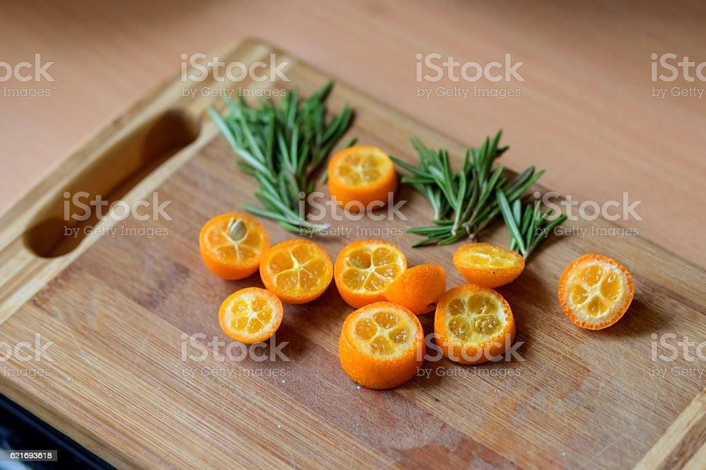 Sliced kumquat, and Basil. stock photo