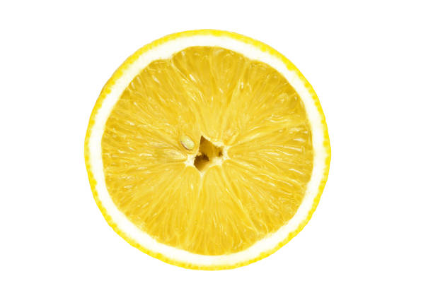 Sliced lemon isolated white background. One sliced isolated lemon on a white background. Top view. Yellow color. limoen stock pictures, royalty-free photos & images