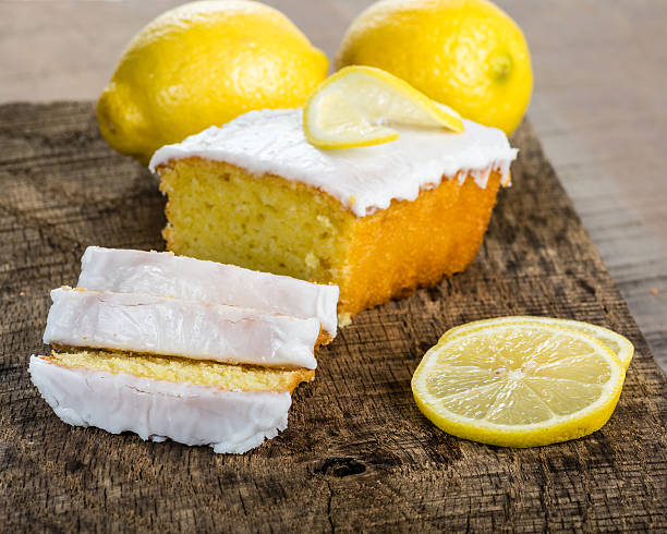 Sliced lemon pound cake with white icing stock photo