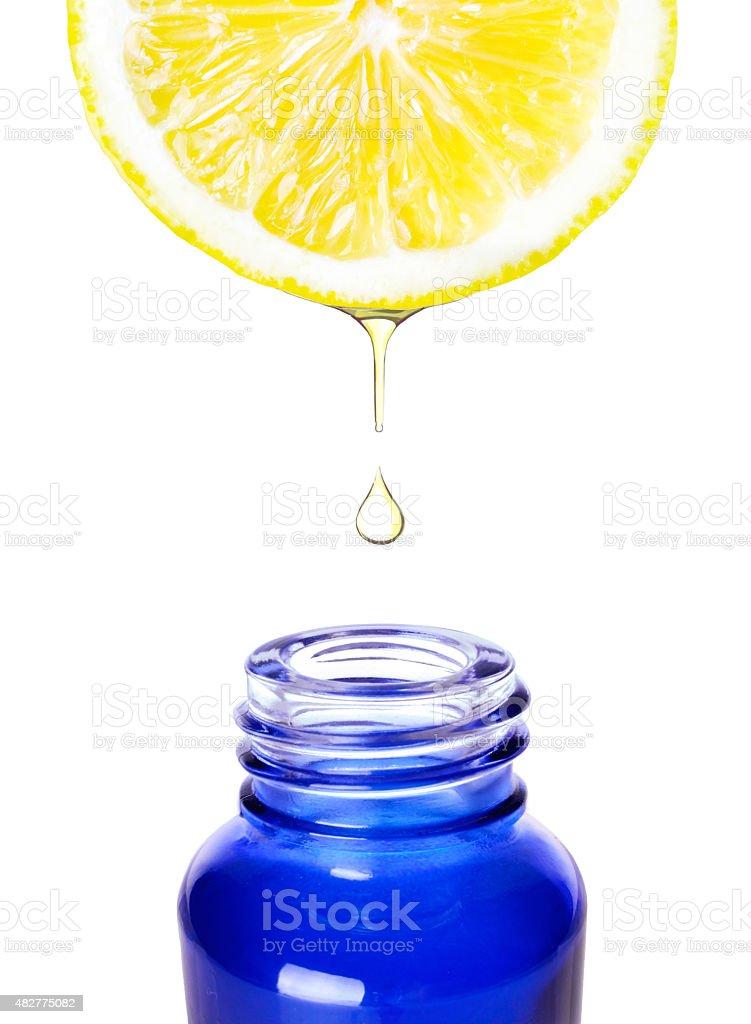 Sliced lemon with juice dropping. Alternative medicine Isolated on white stock photo