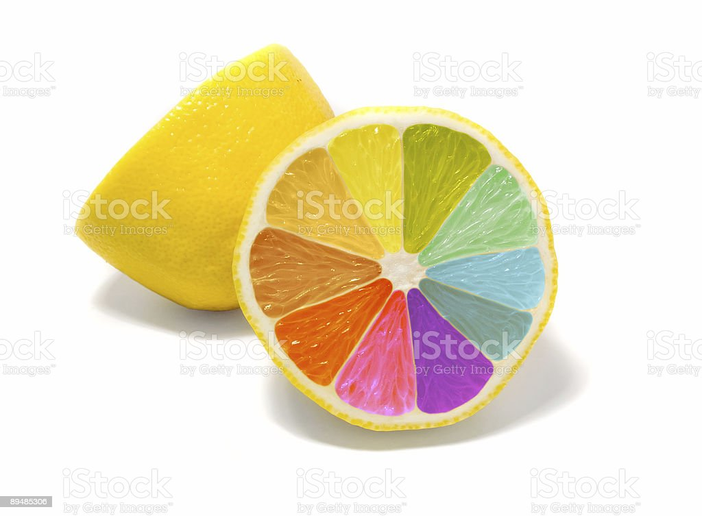 Sliced lemon with rainbow colors inside stock photo