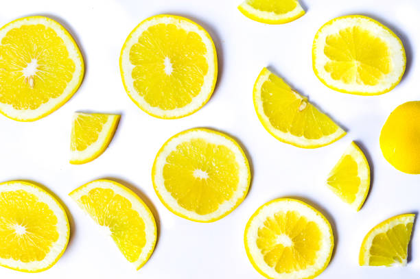 Sliced lemons background pattern isolated stock photo