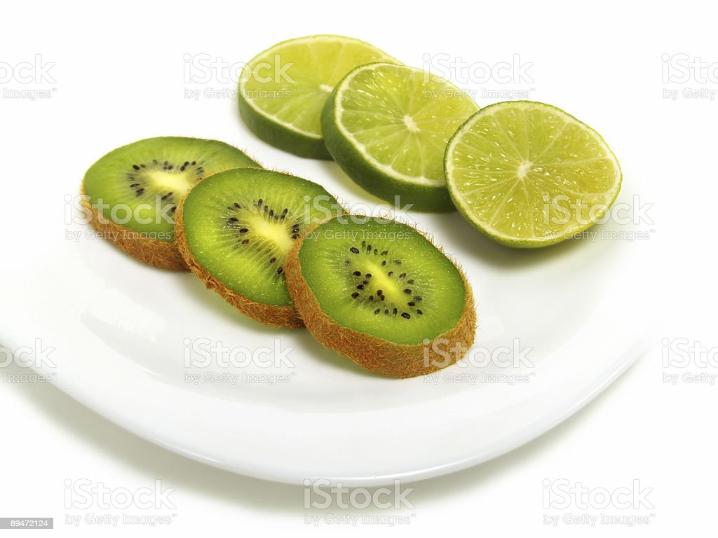 Sliced lime and kiwi on plate royalty-free stock photo