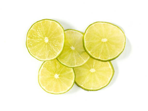 sliced limes stock photo