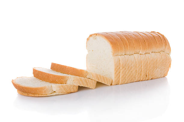 Sliced loaf of bread isolated on white stock photo