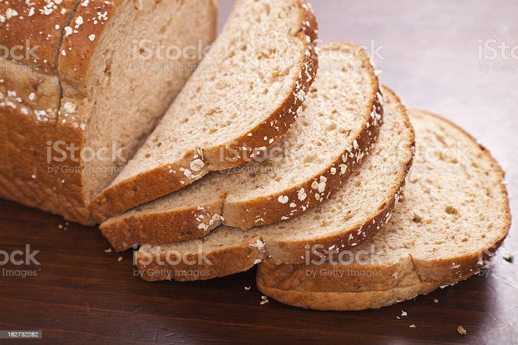 sliced loaf of multi-grain oat bread stock photo