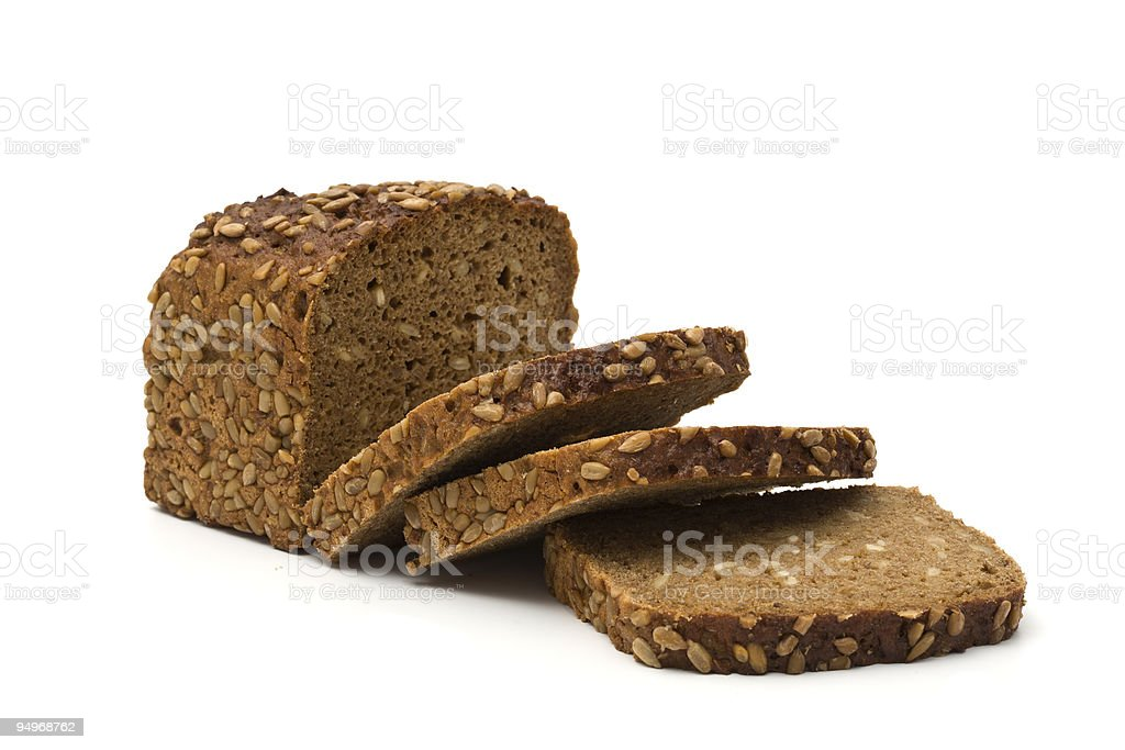 A sliced loaf of whole grain brown bread stock photo