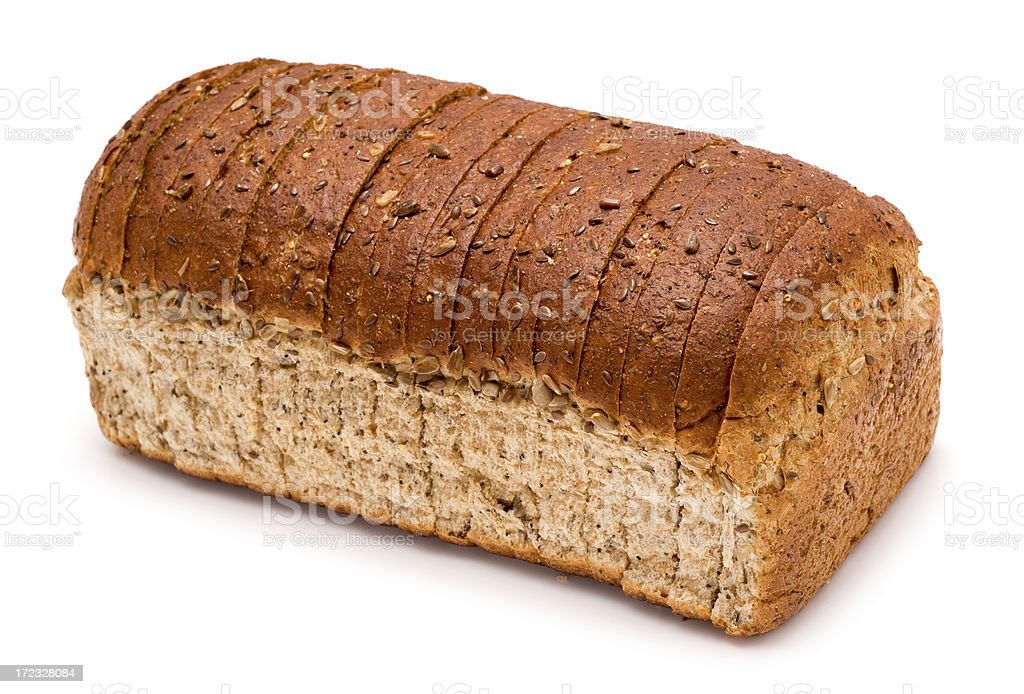 Sliced loaf of wholemeal brown bread on a white background stock photo