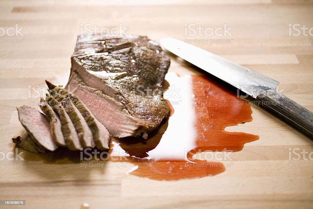 sliced London Broil stock photo