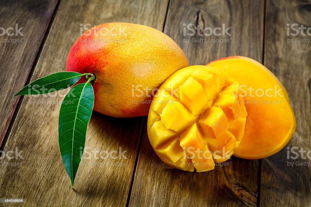Sliced mango on a wooden table. stock photo