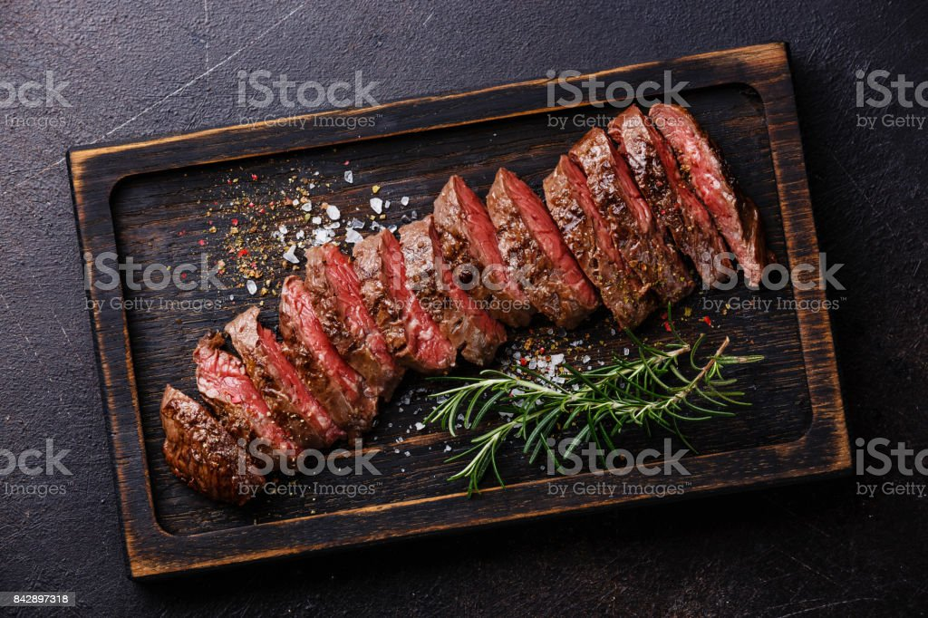 Sliced meat barbecue steak Machete stock photo