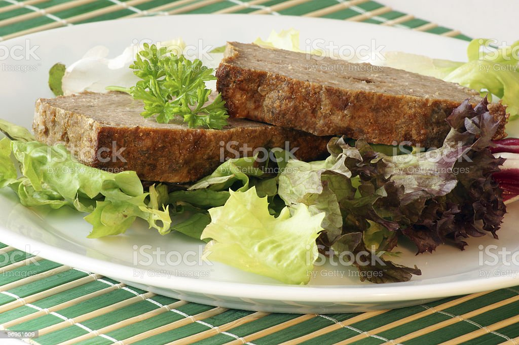 sliced meat loaf with organic vegetable on a plate royalty-free stock photo