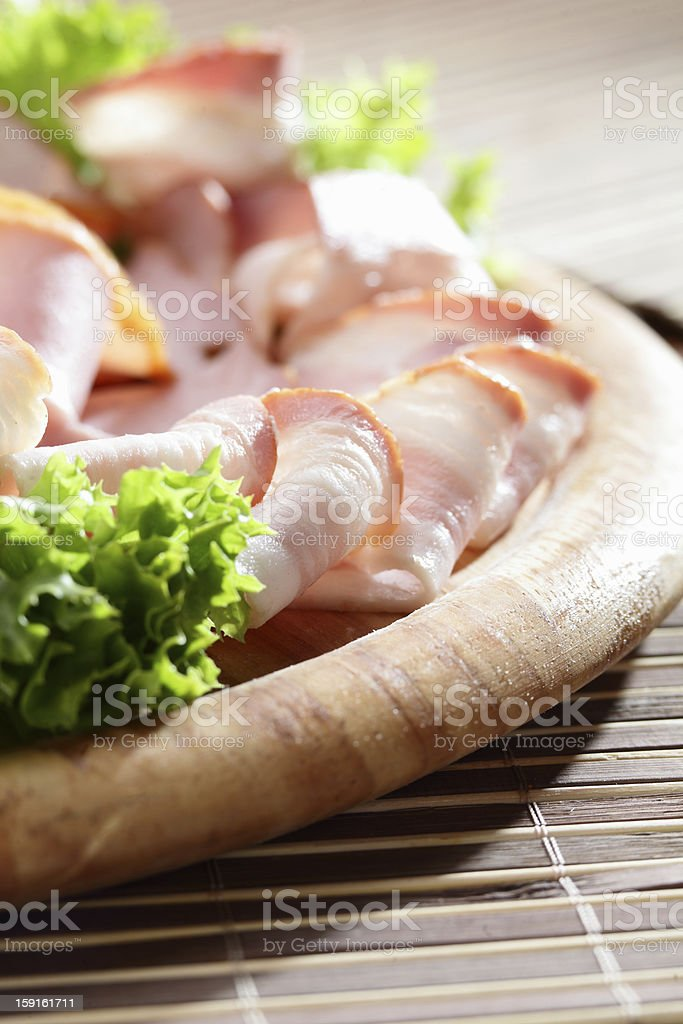 sliced meat on wooden dish royalty-free stock photo