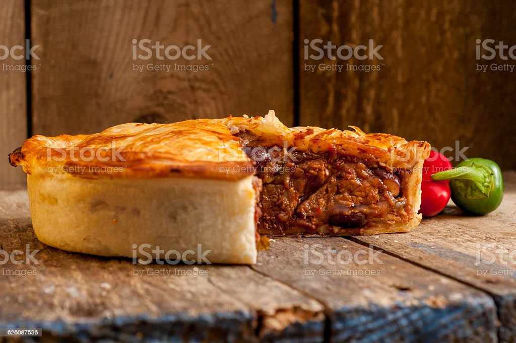 Sliced Meat Pie with Peppers stock photo