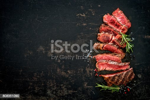 655794674 istock photo Sliced medium rare grilled beef ribeye steak 808351090