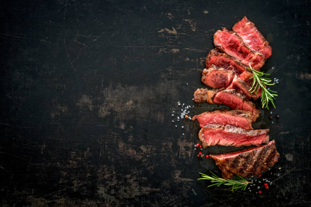 sliced medium rare grilled beef ribeye steak - beef stock pictures, royalty-free photos & images