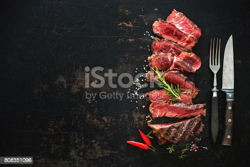 istock Sliced medium rare grilled beef ribeye steak 808351096