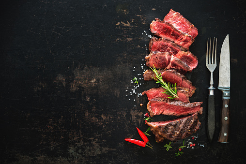 istock Sliced medium rare grilled beef ribeye steak 808351096