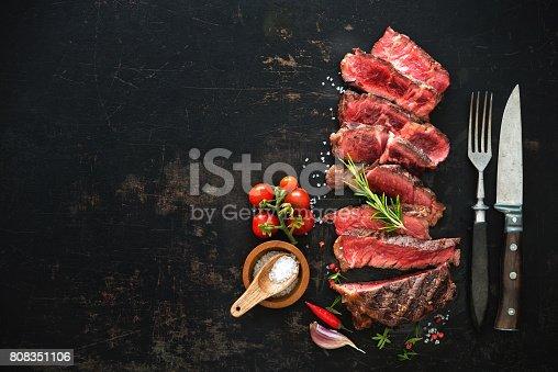 808351106istockphoto Sliced medium rare grilled beef ribeye steak 808351106