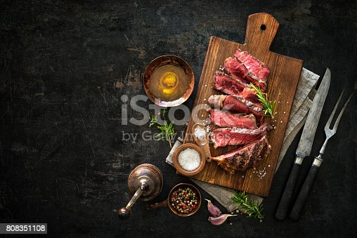 808351106istockphoto Sliced medium rare grilled beef ribeye steak 808351108