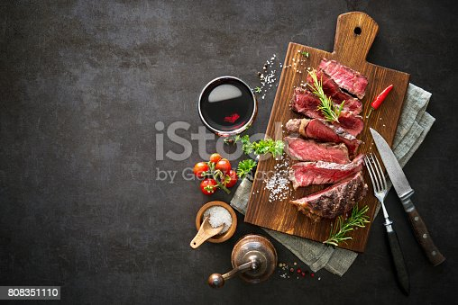 655794674 istock photo Sliced medium rare grilled beef ribeye steak 808351110