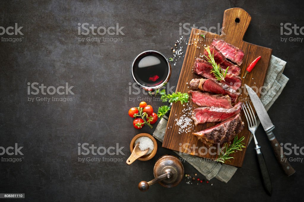 Sliced medium rare grilled beef ribeye steak stock photo
