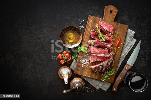 655794674 istock photo Sliced medium rare grilled beef ribeye steak 808351114