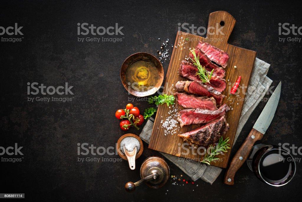 Sliced medium rare grilled beef ribeye steak stock photo