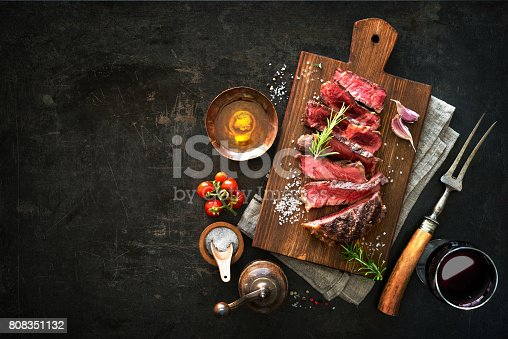655794674 istock photo Sliced medium rare grilled beef ribeye steak 808351132
