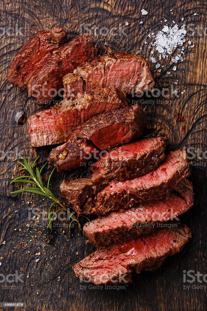 Sliced medium rare grilled Beef steak stock photo