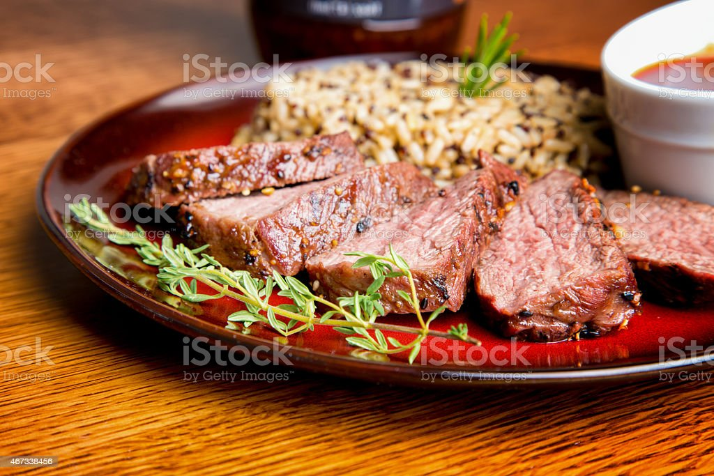 Sliced Medium Rare Grilled Steak with Rice stock photo