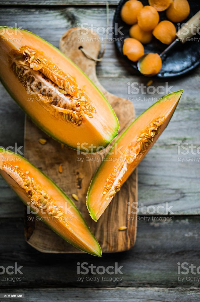 Sliced melon on wooden background stock photo