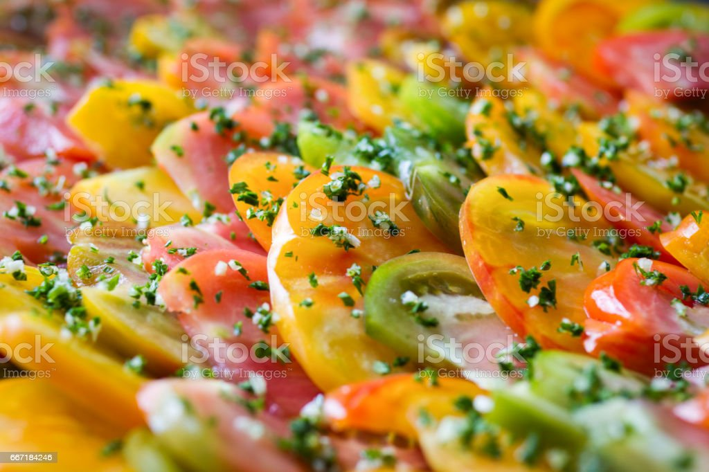 Sliced multicolored tomatoes stock photo