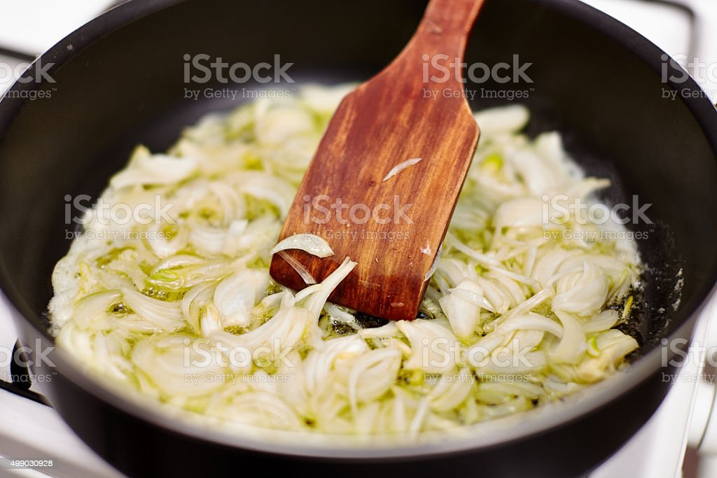 Sliced onion in the pan stock photo