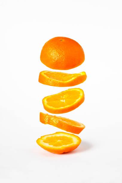 sliced orange - orange fruit stock photos and pictures