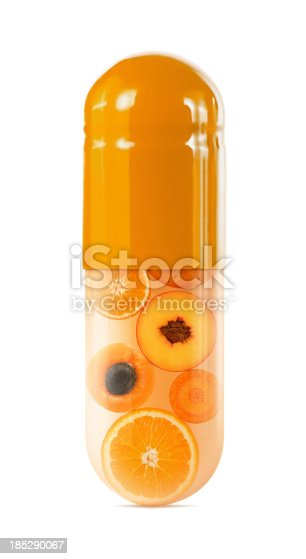 Orange fruits and vegetables in an orange capsule on white background. Clipping path included.