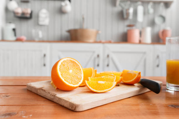 sliced oranges on a wooden cutting board. Healthy and tasty breakfast stock photo