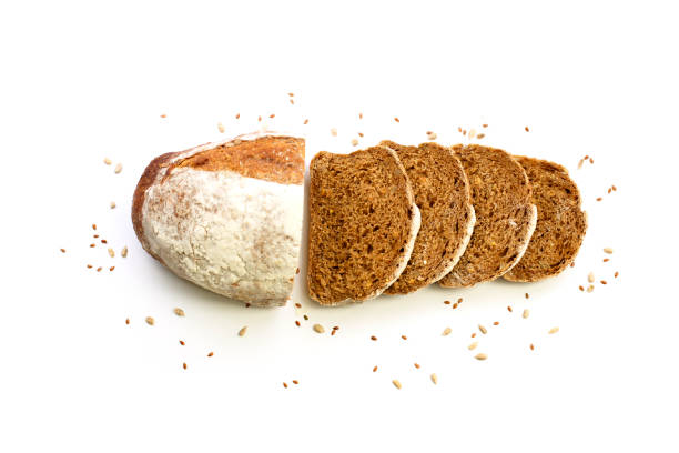 Sliced organic bread with flax seeds arranged isolated on a white background. stock photo