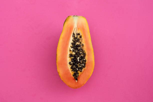Sliced papaya on a pink background stock photo