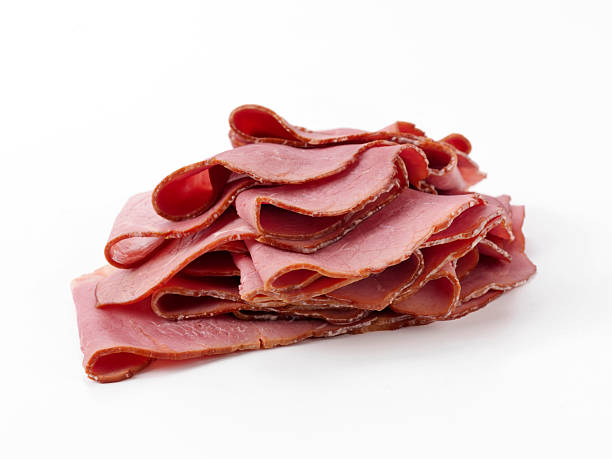 sliced pastrami - pastrami stock pictures, royalty-free photos & images
