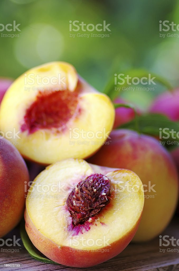 Sliced peaches on table stock photo