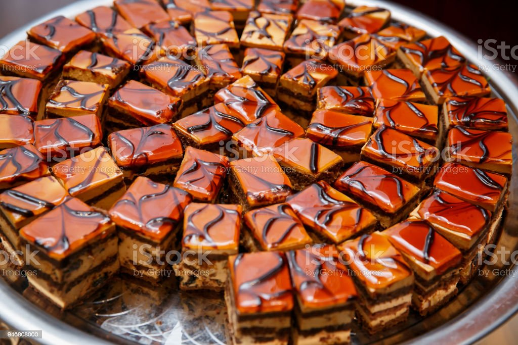 Sliced pieces of cake at event catering. stock photo