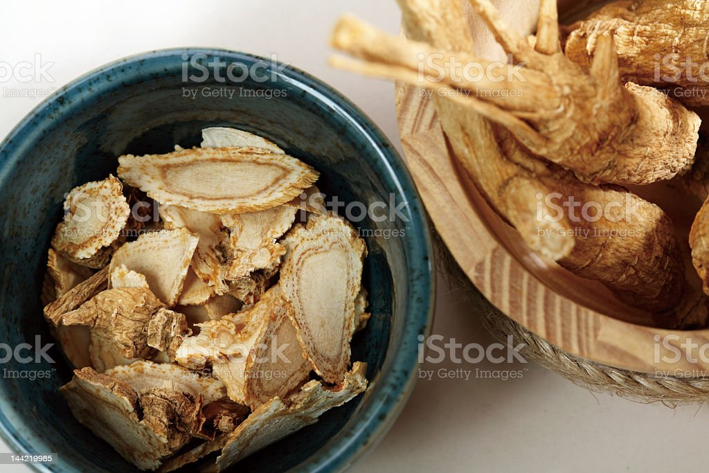 Sliced pieces of ginseng in a bowl stock photo