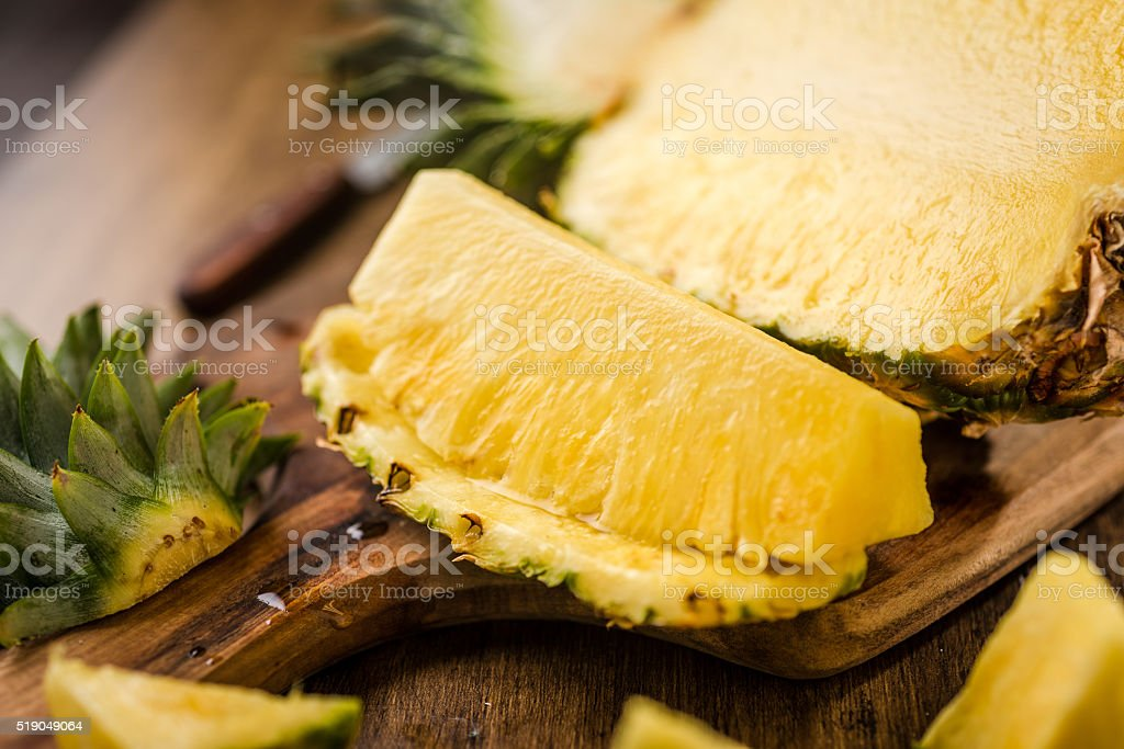 Sliced Pineapple on Chopping Board stock photo