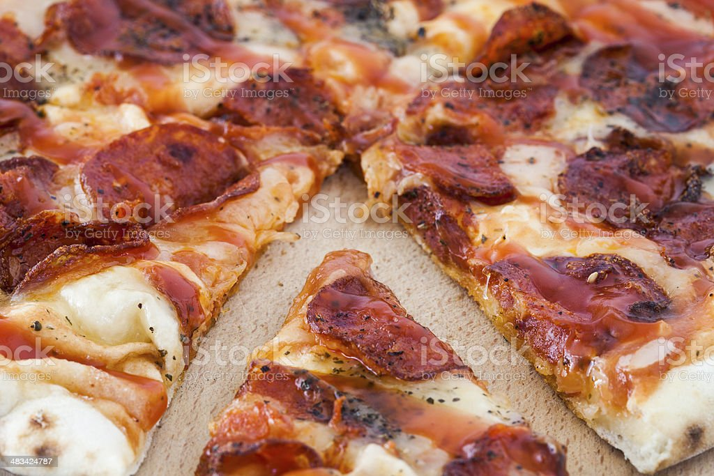 Sliced pizza pie stock photo